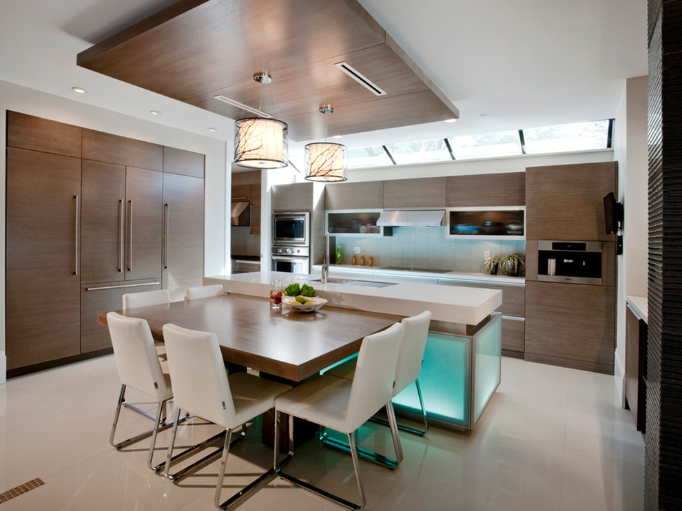 Trendy eat-in kitchen photo in Vancouver with beige backsplash, paneled appliances, medium tone wood cabinets and marble countertops