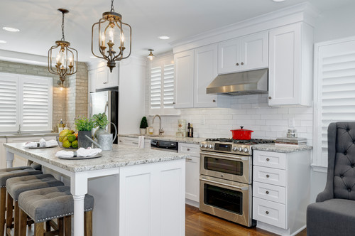 Tonal kitchen with Alaska White granite countertops