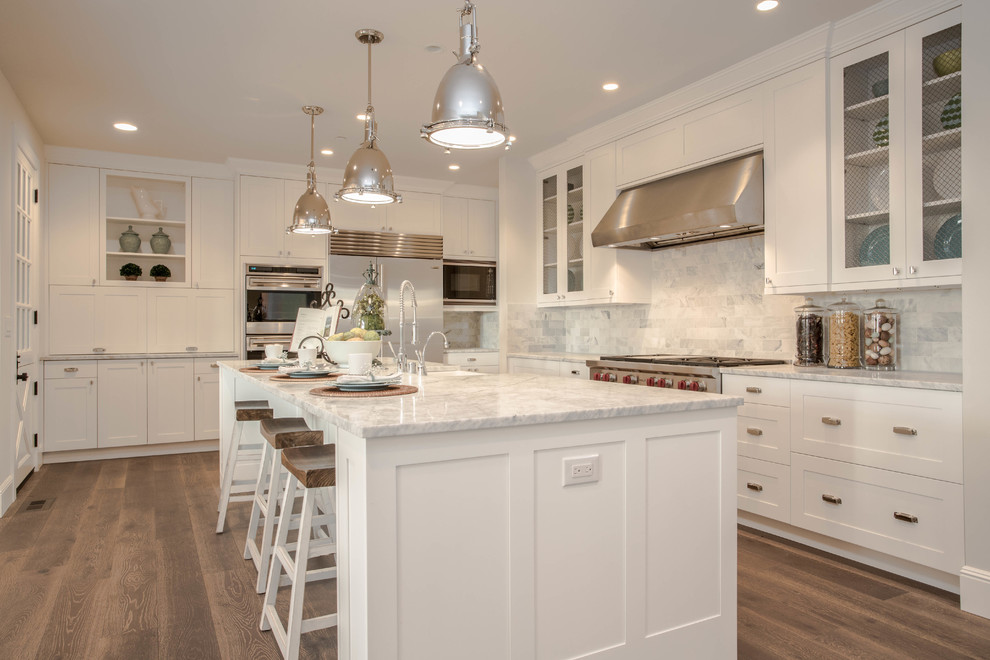 Farmhouse l-shaped dark wood floor kitchen photo in Seattle with shaker cabinets, white cabinets, marble countertops, white backsplash, stainless steel appliances and marble backsplash