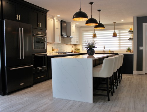 White countertops and black cabinets with gold