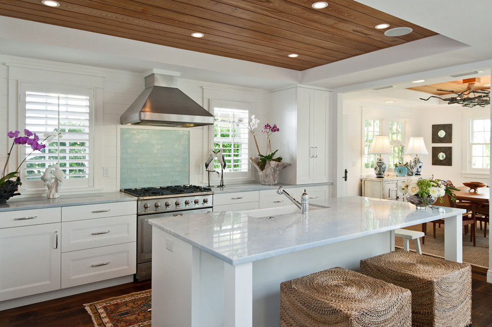 Eat-in kitchen - coastal eat-in kitchen idea in Miami with a farmhouse sink, recessed-panel cabinets, white cabinets, subway tile backsplash and stainless steel appliances