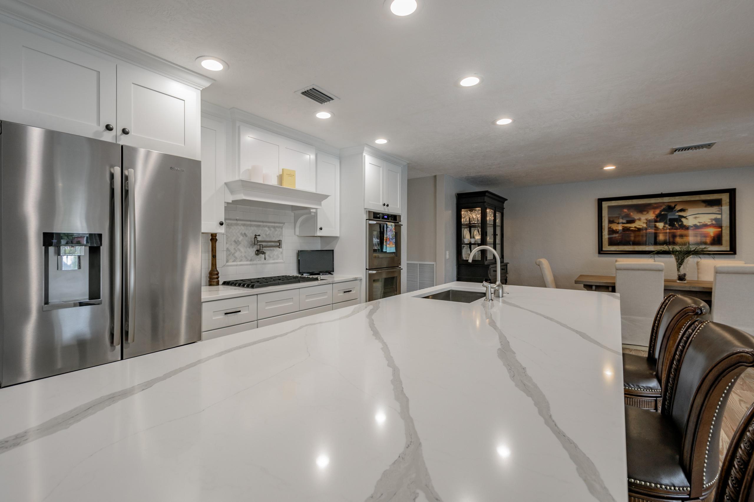 Coastal kitchen with natural pine floors