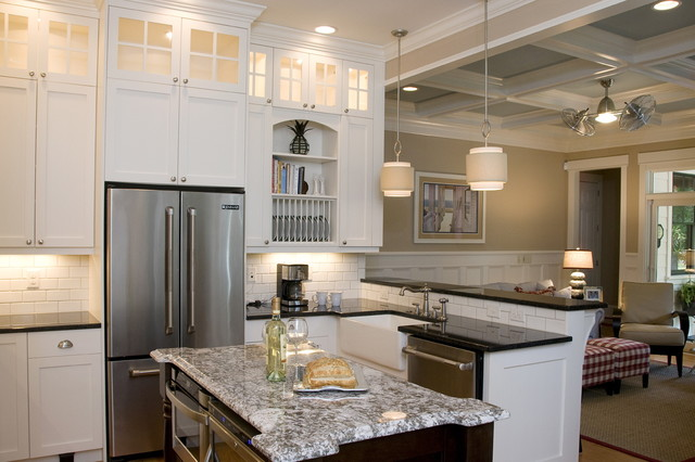 Open concept kitchen - beach style u-shaped open concept kitchen idea in Raleigh with stainless steel appliances, a farmhouse sink, recessed-panel cabinets, white cabinets, granite countertops, white backsplash and subway tile backsplash