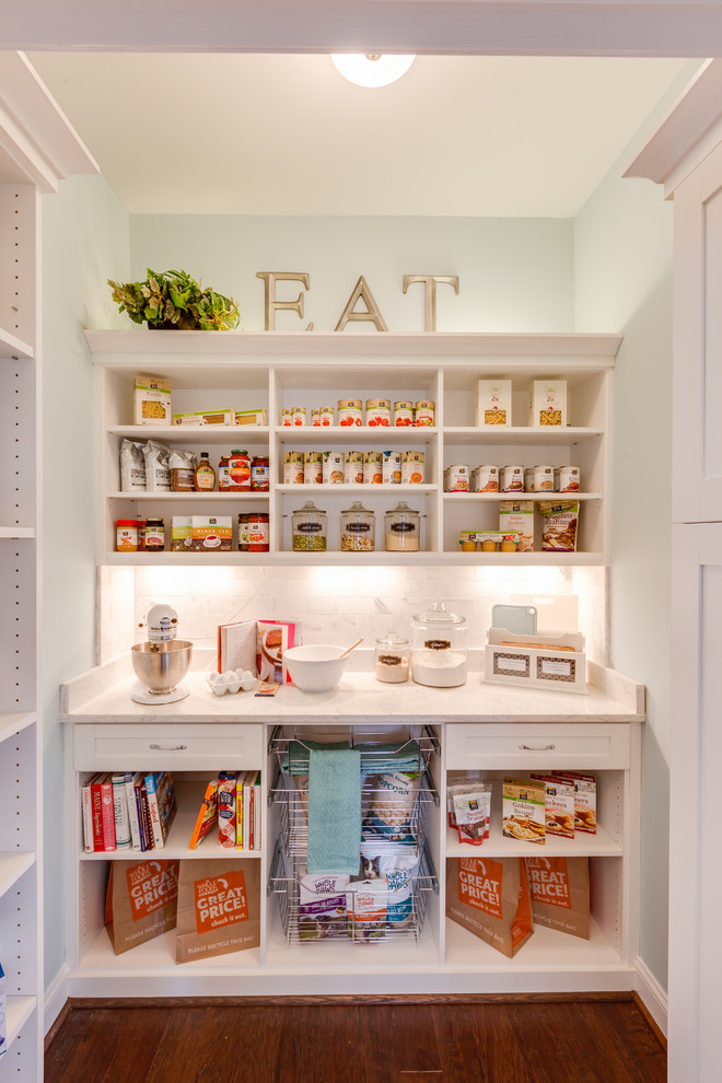 Example of a small classic single-wall dark wood floor kitchen pantry design in Other with open cabinets and white cabinets
