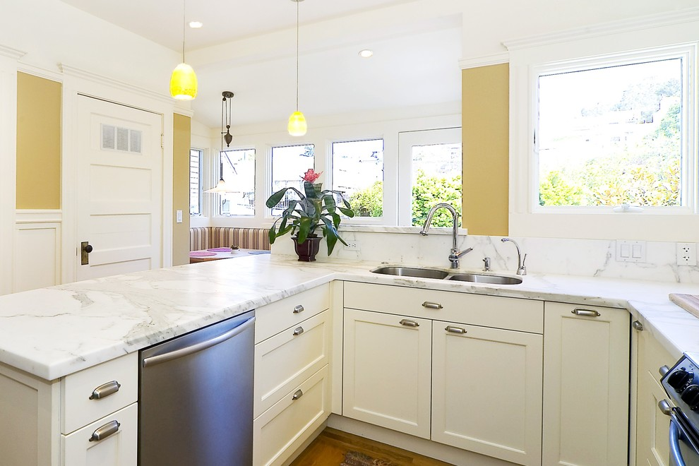 Elegant kitchen photo in San Francisco with stainless steel appliances, an undermount sink and marble countertops