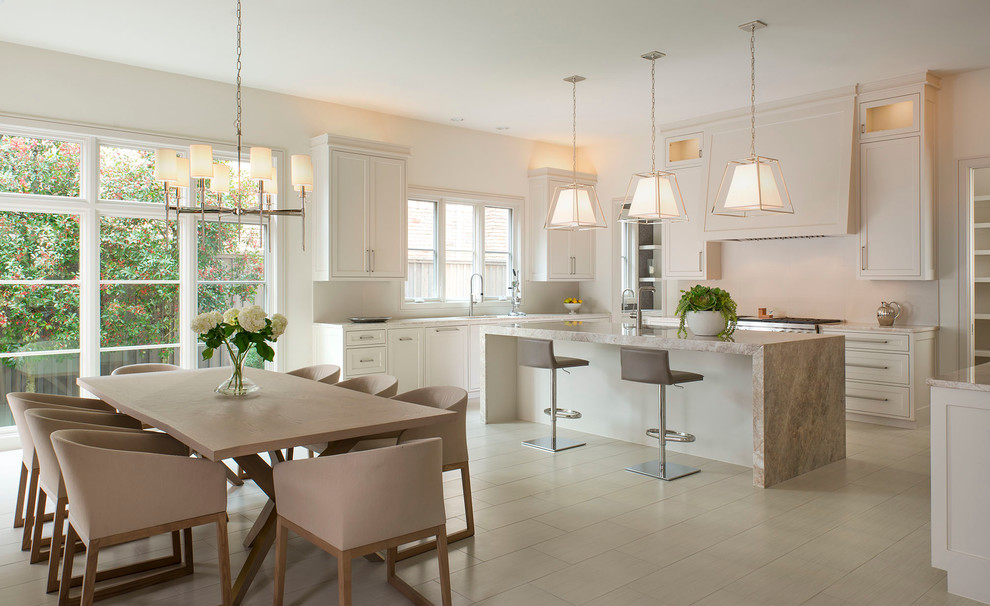 Eat-in kitchen - transitional eat-in kitchen idea in Dallas with an undermount sink, shaker cabinets, beige cabinets and an island