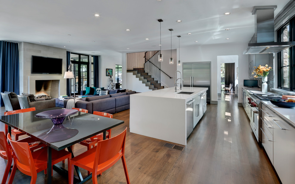 Trendy open concept kitchen photo in Dallas with a double-bowl sink, flat-panel cabinets, white cabinets and stainless steel appliances