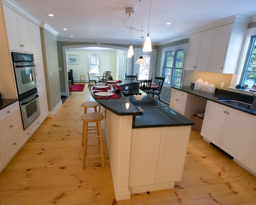 Knotty pine floors in a kitchen. Good luck with that!