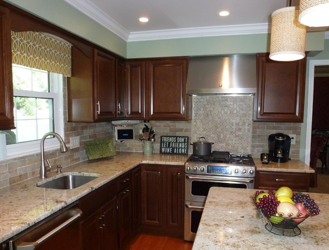 colonial gold counters with faux brick backsplash traditional kitchen