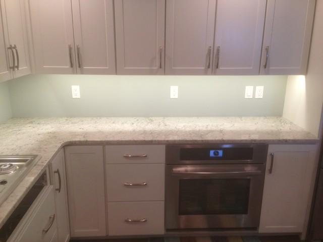 Colonial white granite traditional kitchen grand for Bathroom cabinets grand rapids mi