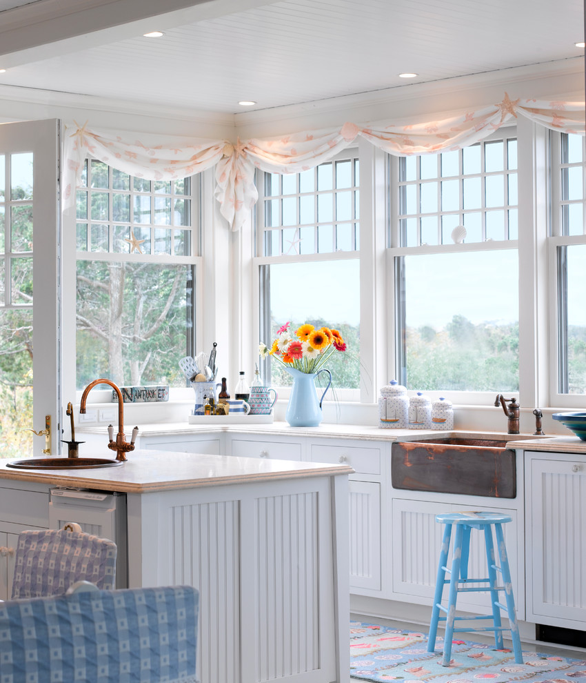 Coastal eat-in kitchen photo in Boston with a farmhouse sink, shaker cabinets and white cabinets