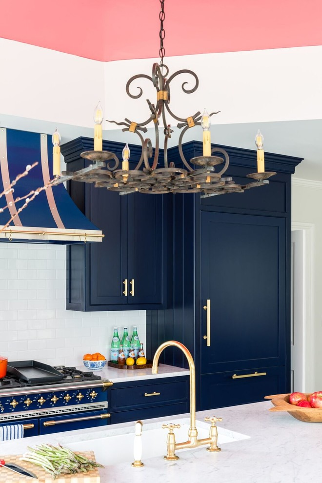 Kitchen - transitional kitchen idea in Boston with an undermount sink, shaker cabinets, blue cabinets, white backsplash, subway tile backsplash, colored appliances and an island