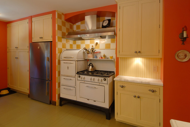 midsized eclectic lshaped painted wood floor and beige floor enclosed kitchen idea