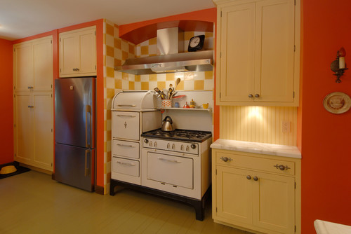 Kitchen with a stove and fridge lined next to each other