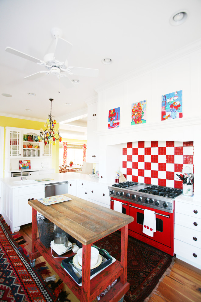Eclectic kitchen photo in Other with white cabinets, red backsplash and colored appliances