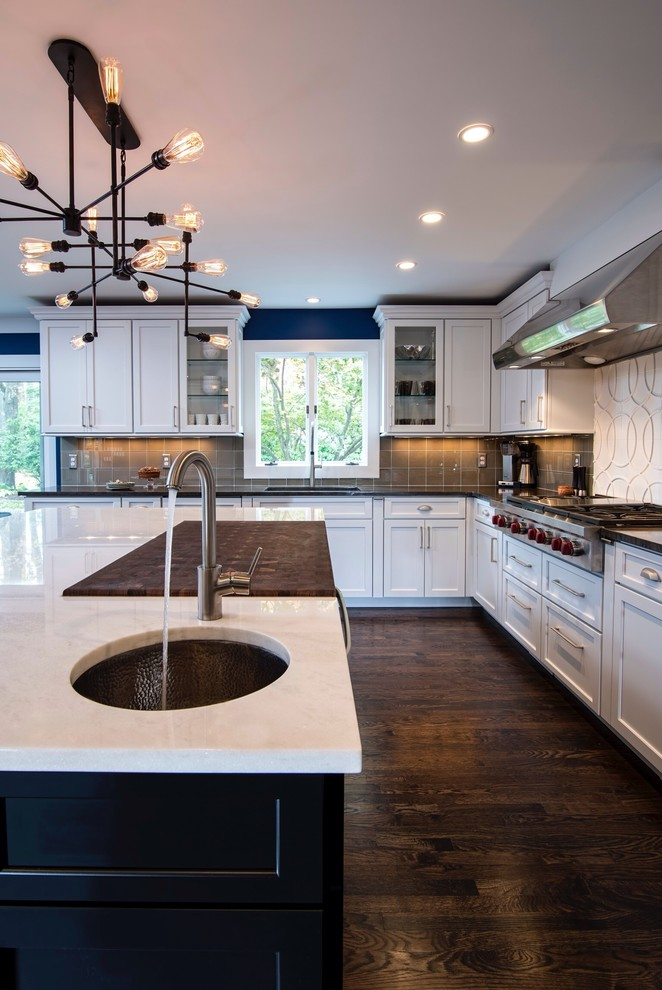 Eat-in kitchen - large transitional u-shaped dark wood floor eat-in kitchen idea in New York with an undermount sink, recessed-panel cabinets, white cabinets, brown backsplash, marble countertops, an island, glass tile backsplash and stainless steel appliances