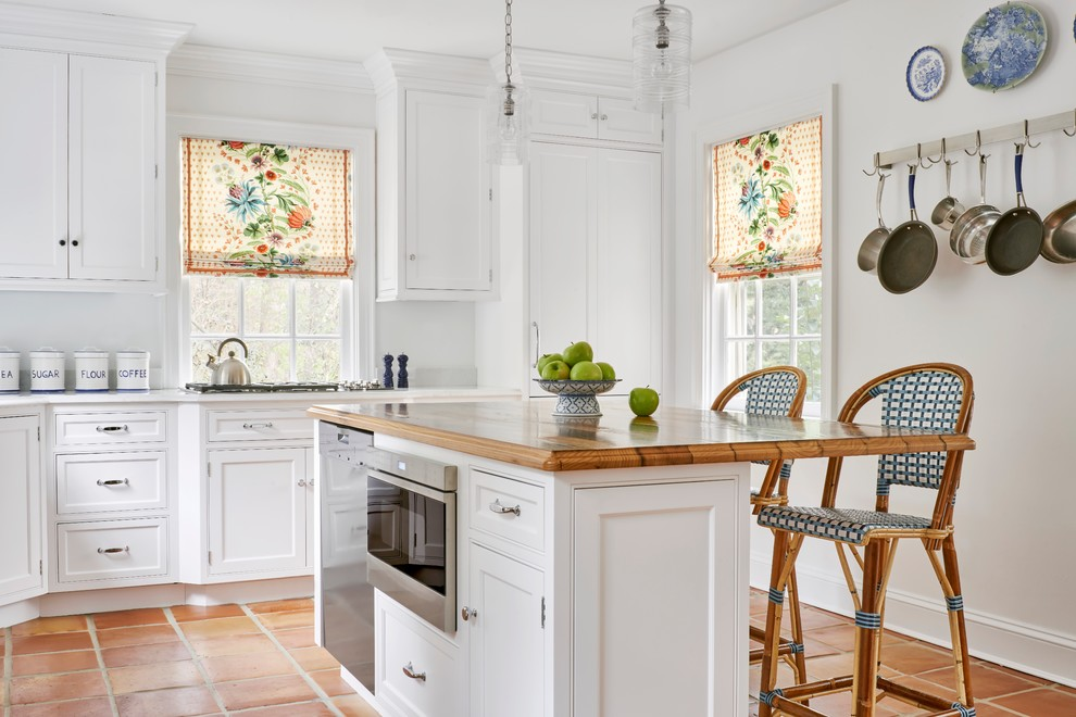 Kitchen - traditional terra-cotta tile kitchen idea in Richmond with beaded inset cabinets, white cabinets, stainless steel appliances and an island