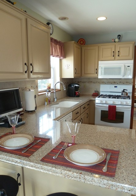 Compact kitchen with painted cabinets and white appliances for Traditional kitchen appliances