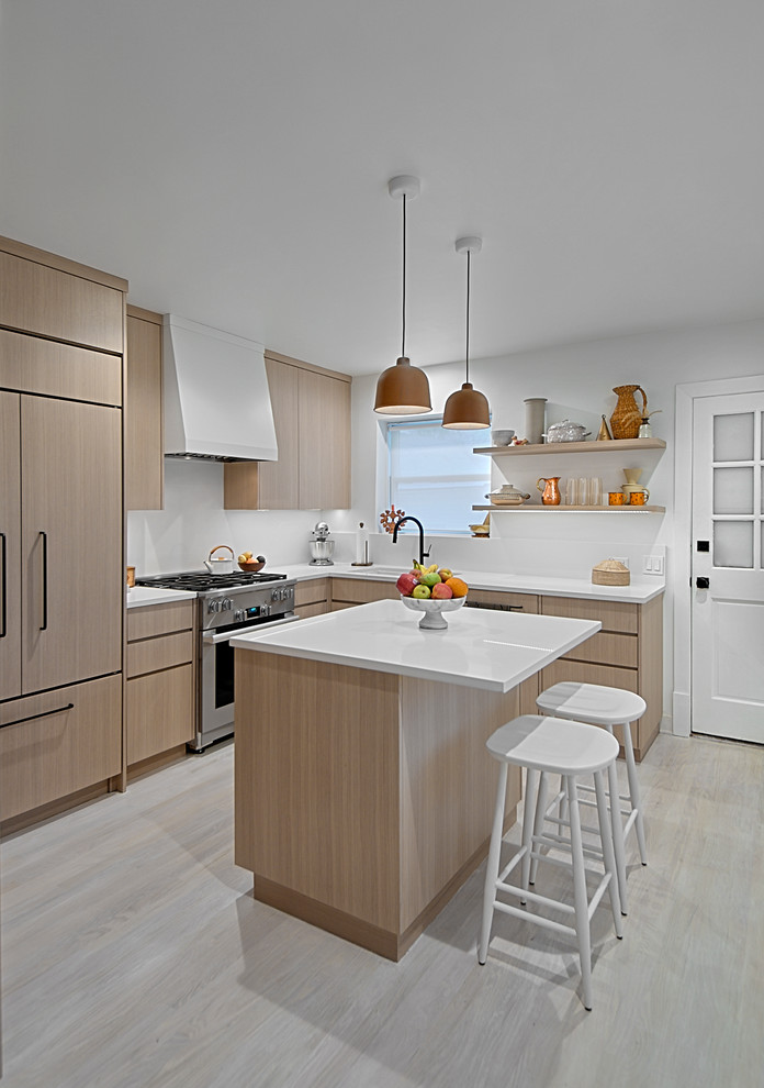 Kitchen - small contemporary l-shaped light wood floor and gray floor kitchen idea in Chicago with an undermount sink, flat-panel cabinets, light wood cabinets, quartz countertops, white backsplash, stone slab backsplash, stainless steel appliances, an island and white countertops