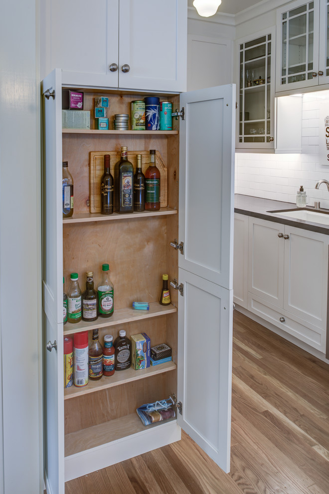 Inspiration for a small contemporary galley light wood floor kitchen pantry remodel in San Francisco with an undermount sink, shaker cabinets, white cabinets, brown backsplash, ceramic backsplash, stainless steel appliances and no island