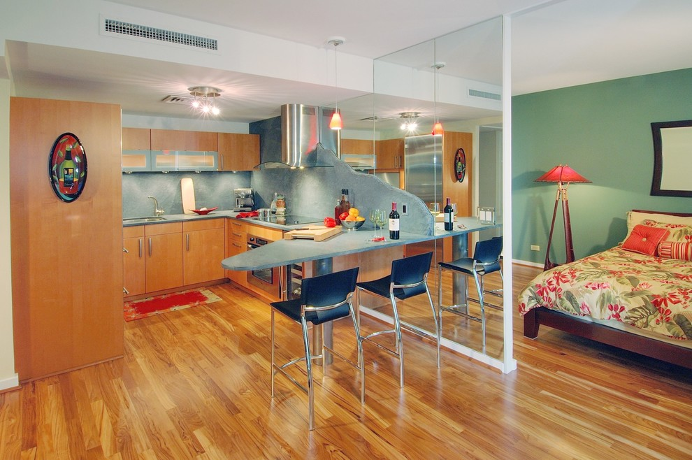 Example of a trendy kitchen design in Hawaii with stainless steel appliances