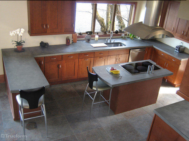 Example Of A Large Trendy L Shaped Light Wood Floor Eat In Kitchen Design