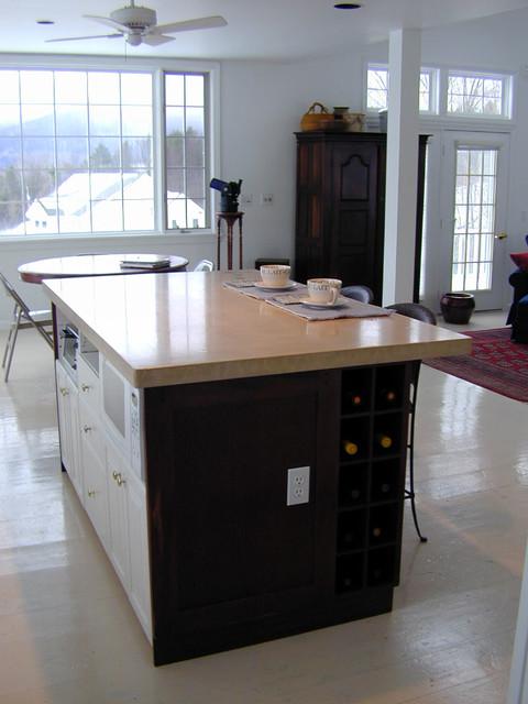concrete kitchen island top in large white kitchen