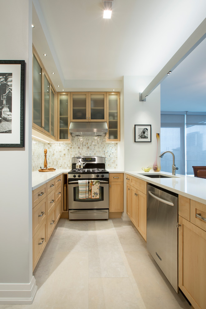 Inspiration for a small contemporary eat-in kitchen remodel in Toronto with shaker cabinets and light wood cabinets