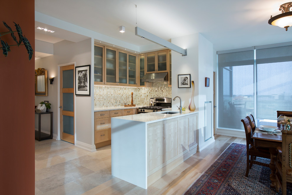Eat-in kitchen - small contemporary eat-in kitchen idea in Toronto with glass-front cabinets and light wood cabinets