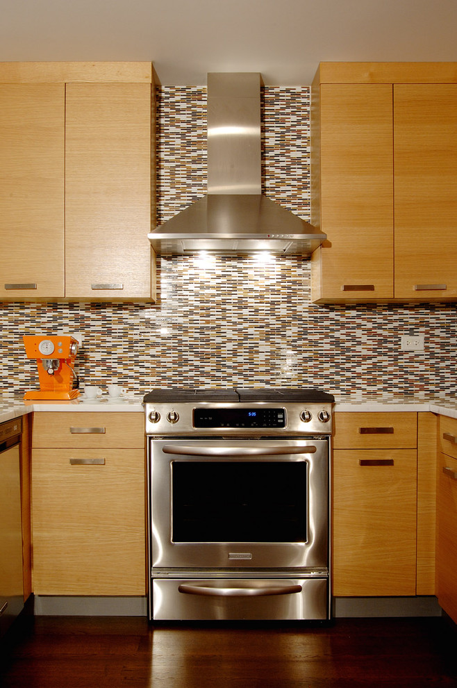 Eat-in kitchen - contemporary u-shaped eat-in kitchen idea in Chicago with stainless steel appliances, flat-panel cabinets, medium tone wood cabinets, matchstick tile backsplash and multicolored backsplash