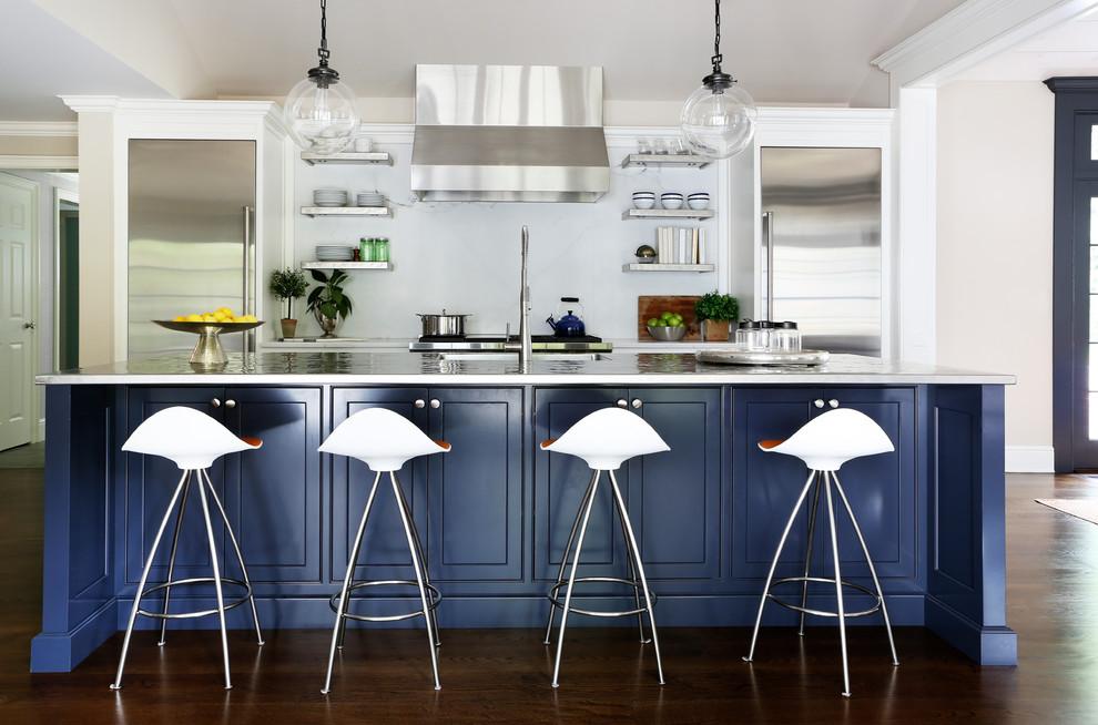Kitchen - transitional galley dark wood floor kitchen idea in New York with an island, white backsplash and stainless steel appliances