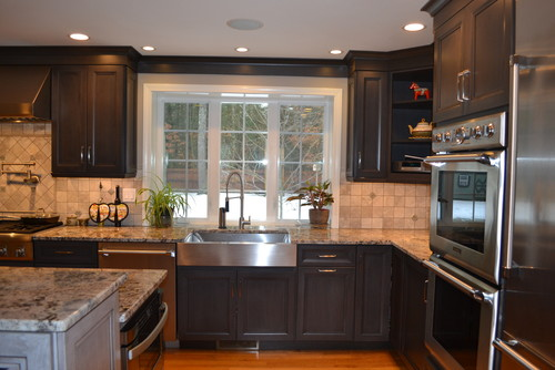 What Is Backsplash Paired With Blue Flowers Granite?