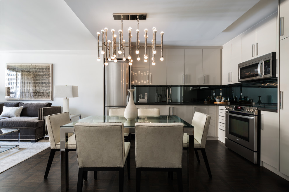 Inspiration for a small contemporary l-shaped dark wood floor and brown floor open concept kitchen remodel in Toronto with an undermount sink, flat-panel cabinets, gray cabinets, quartz countertops, stainless steel appliances, no island and black backsplash