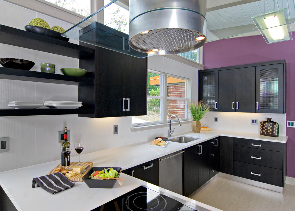 Example of a trendy kitchen design in Other with flat-panel cabinets, quartz countertops, an undermount sink and black cabinets