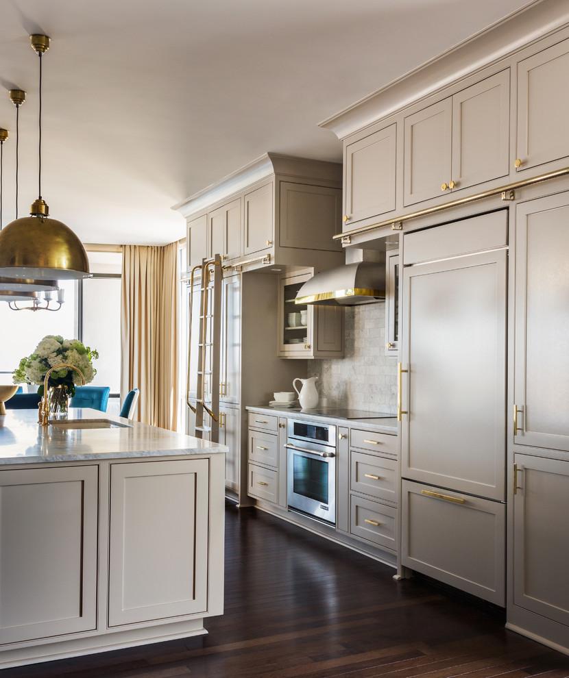 Transitional kitchen photo in Little Rock with gray cabinets, white backsplash, stone tile backsplash and an island