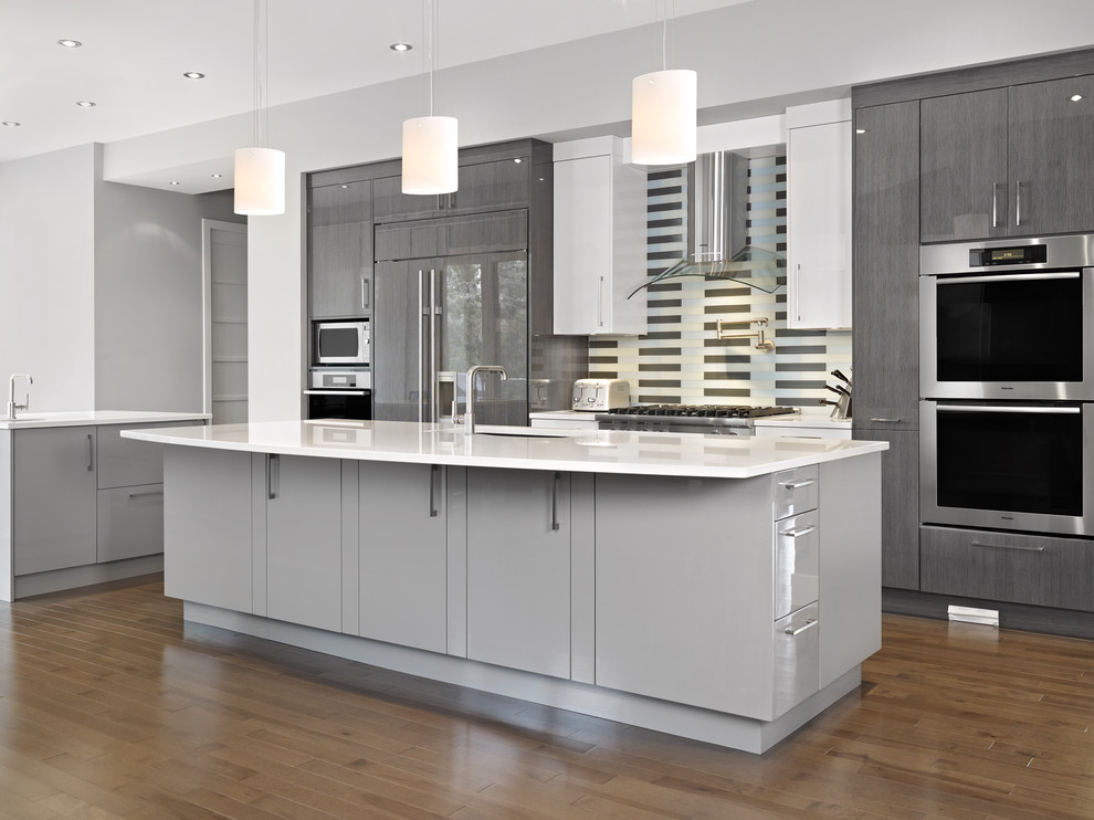 Kitchen - contemporary galley kitchen idea in Edmonton with paneled appliances, flat-panel cabinets, gray cabinets and multicolored backsplash