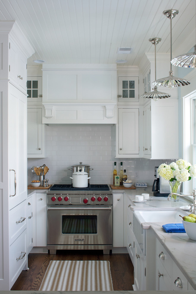 Example of a small country u-shaped enclosed kitchen design in Other with white cabinets, quartzite countertops, white backsplash, subway tile backsplash, stainless steel appliances and a farmhouse sink