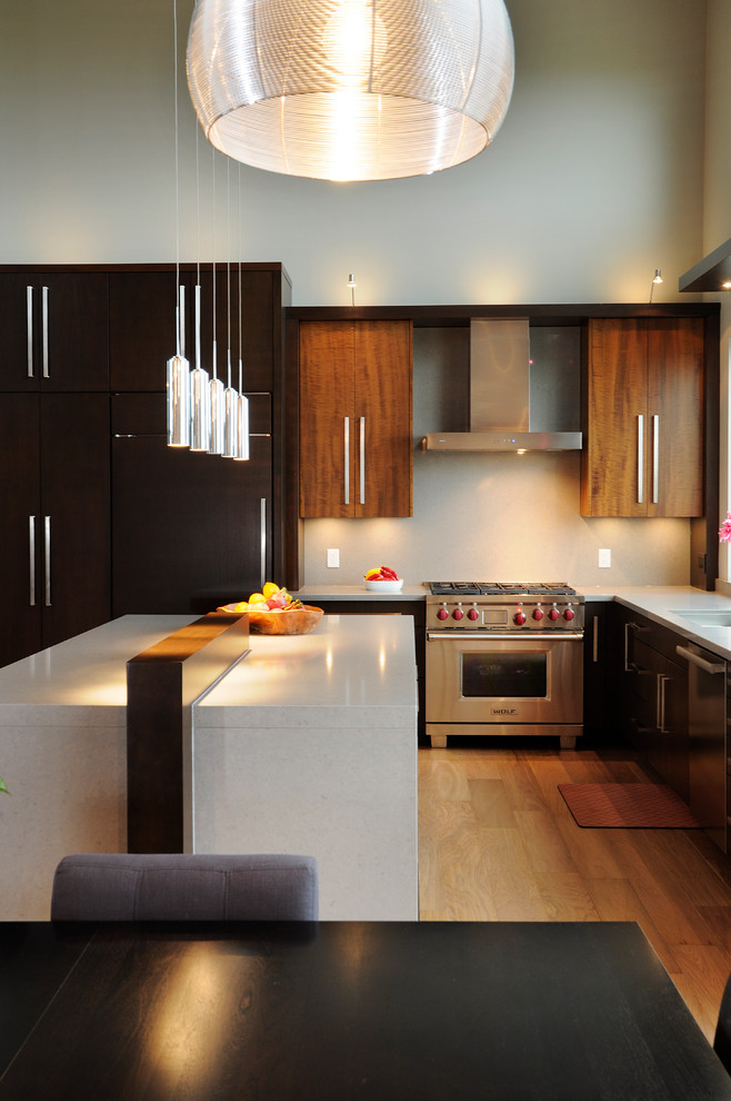 Huge trendy l-shaped eat-in kitchen photo in Toronto with an undermount sink, flat-panel cabinets, dark wood cabinets, quartz countertops and paneled appliances