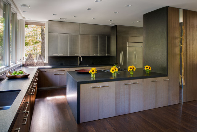 Kitchen - contemporary l-shaped dark wood floor kitchen idea in New York with an undermount sink, flat-panel cabinets, medium tone wood cabinets, stainless steel appliances and a peninsula