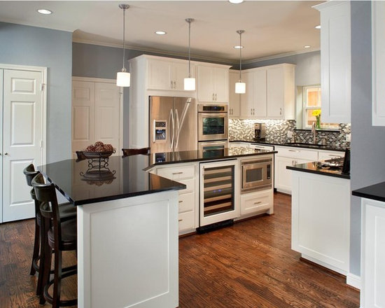 with Stainless Steel Appliances, Brown Backsplash and White Cabinets