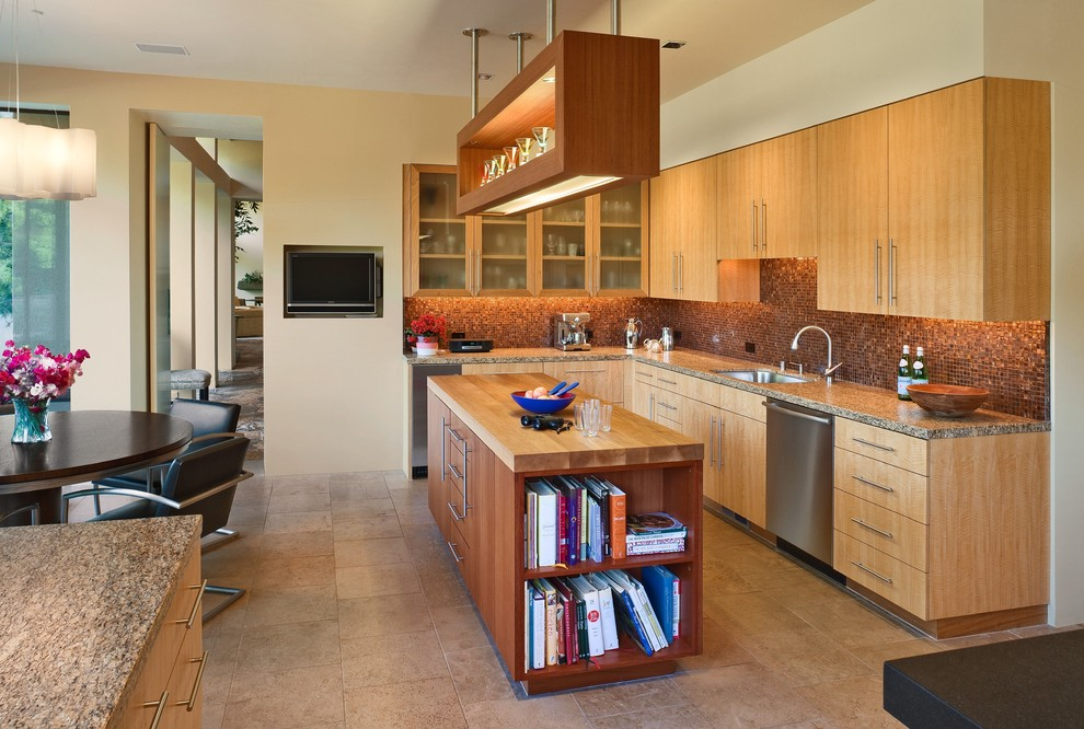 Example of a trendy eat-in kitchen design in San Francisco with wood countertops, an undermount sink, flat-panel cabinets, medium tone wood cabinets, metallic backsplash, mosaic tile backsplash and stainless steel appliances