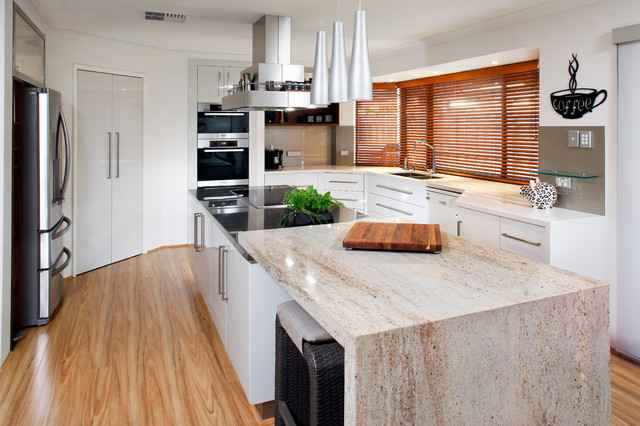 Photo of a contemporary kitchen in Perth with flat-panel cabinets, white cabinets, brown splashback, glass sheet splashback, stainless steel appliances, an undermount sink and granite benchtops.