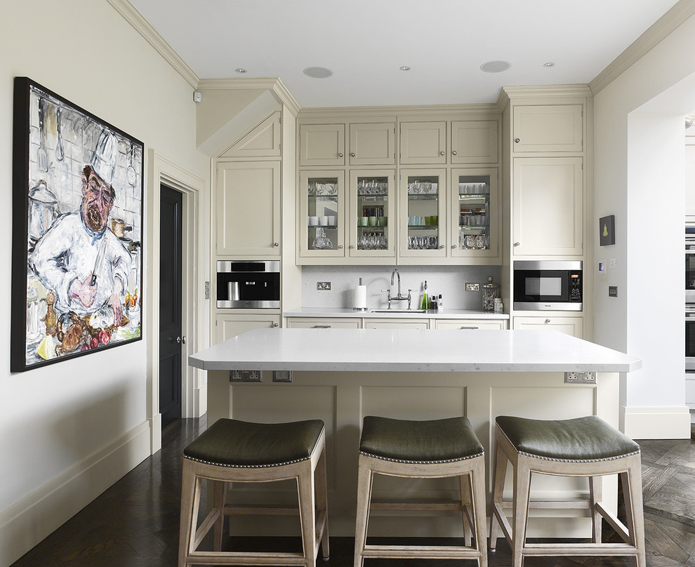 Kitchen - contemporary kitchen idea in Philadelphia with glass-front cabinets and stainless steel appliances