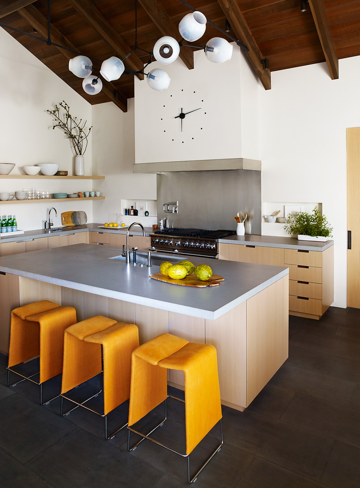 Inspiration for a contemporary l-shaped black floor kitchen remodel in San Francisco with an integrated sink, flat-panel cabinets, light wood cabinets, concrete countertops, stainless steel appliances and an island
