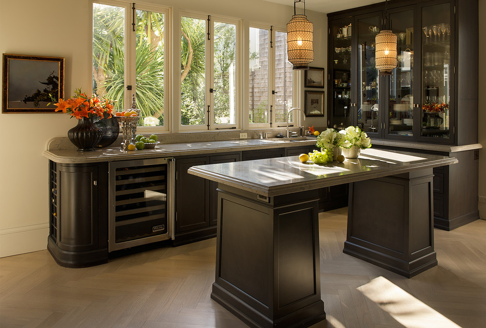 Trendy l-shaped kitchen photo in San Francisco with glass-front cabinets and dark wood cabinets