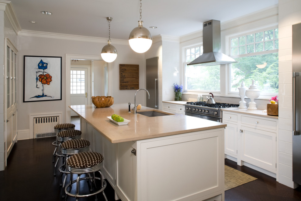 Trendy galley kitchen photo in New York with an undermount sink, shaker cabinets, white cabinets and stainless steel appliances