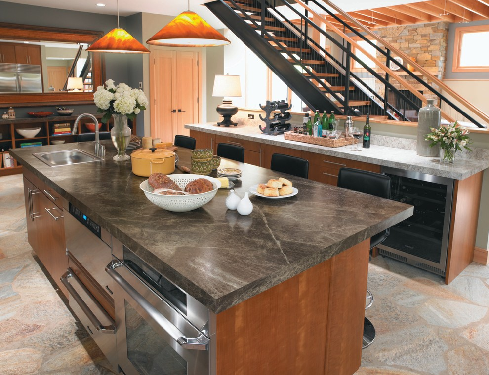 Trendy kitchen photo in Cincinnati with stainless steel appliances, a drop-in sink, flat-panel cabinets, medium tone wood cabinets and laminate countertops