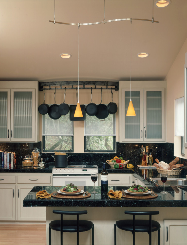 Trendy kitchen photo in San Francisco with glass-front cabinets, beige cabinets, black backsplash and white appliances
