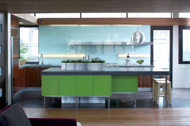 Inspiration for a contemporary l-shaped eat-in kitchen remodel in Other with an undermount sink, flat-panel cabinets, dark wood cabinets, concrete countertops, blue backsplash, glass sheet backsplash and stainless steel appliances