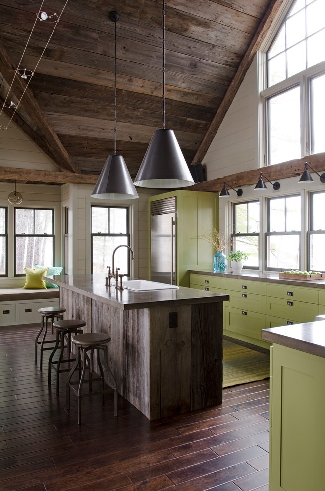 Example of a trendy kitchen design in Portland Maine with concrete countertops, a drop-in sink, shaker cabinets, green cabinets and stainless steel appliances